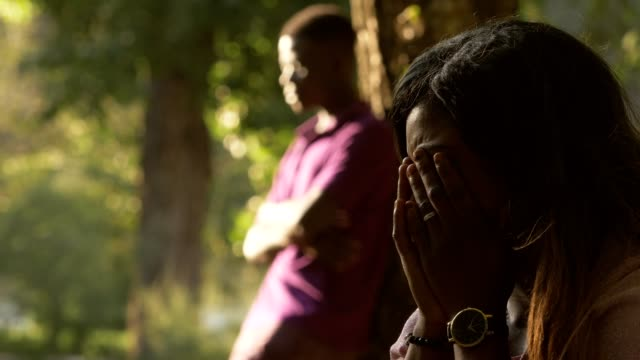 African-couple-after-arguing-in-the-park-Silence-sadness-cry