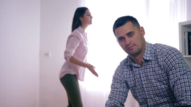 nervous-breakdown-unhappy-man-in-shock-from-swearing-with-furious-wife-during-psychosis-with-aggressive-gestures