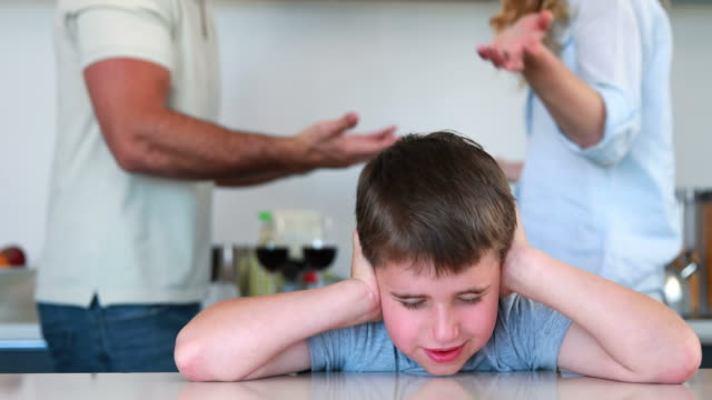 Little-boy-blocking-out-noise-from-parents-fighting