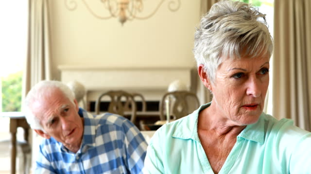 Senior-couple-arguing-with-each-other-in-the-living-room