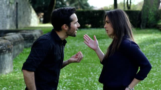 couple-arguing-for-a-betrayal-in-a-park