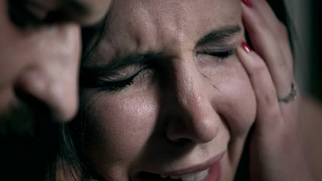 desperate-sad-woman-cries-on-the-shoulder-of-her-boyfriend