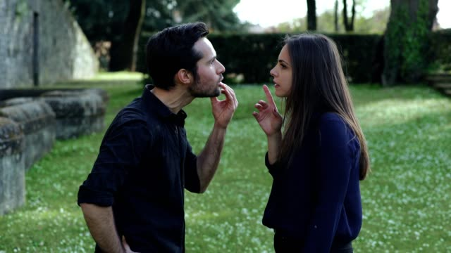 angry-boyfriend-arguing-furiously-with-his-girlfriend-in-the-park