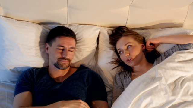 Young-couple-arguing-in-bed-at-home-4K-