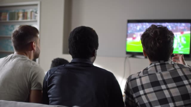 Friends-Watching-Soccer-on-TV-at-Home