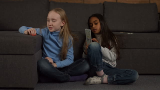 Adorable-diverse-kids-watching-TV-at-home