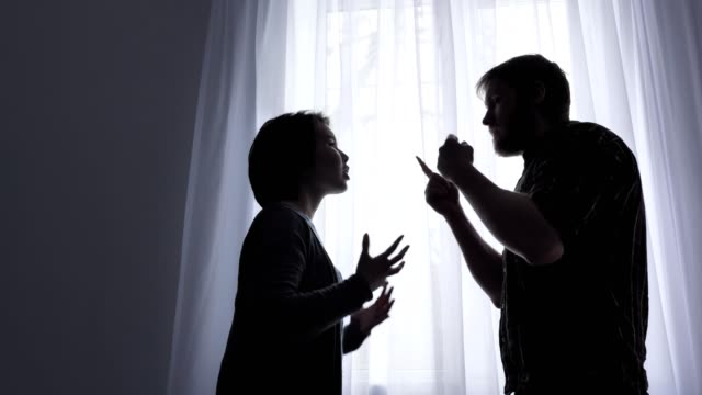 Quarrel-of-a-young-family-conflict-concept-domestic-violence-window-in-the-background-50-fps