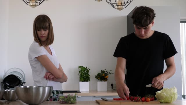 Young-couple-arguing-while-making-a-vegetable-meal-woman-gets-angry-slow-motion