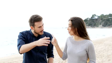 Couple-or-friends-arguing-on-the-beach