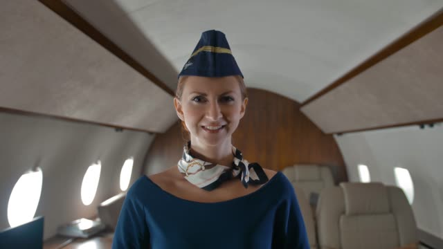 Young-stewardess-inside-of-private-jet-cabin