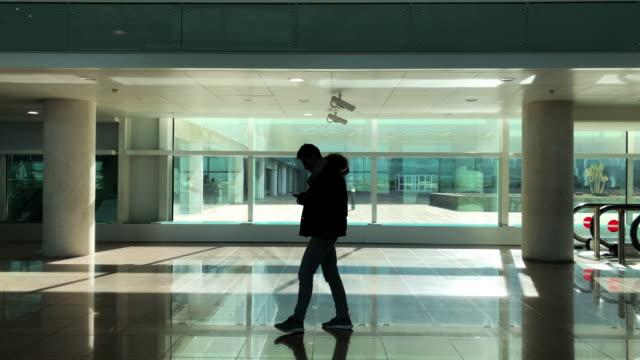 Man-walking-down-airport