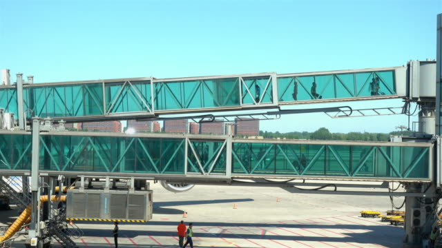the-passengers-out-of-the-aircraft-through-a-glass-passage-in-Beijing-international-airport-
