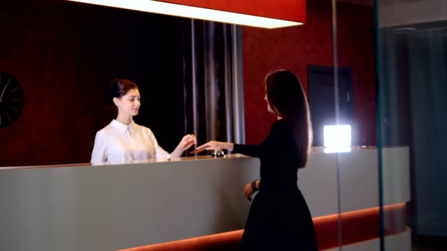 Hotel-service-manager-greeting-new-customer-businesswoman-4K-