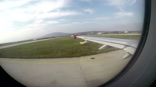 Passenger-plane-window-POV-on-arrival-at-airport