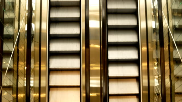 Escalator-in-metro-Moving-up-staircase-escalator-electric-escalator-Close-up-to-escalators-electric-escalator-Close-up-floor-platform-yellow-bands-metal-line-steel-yellow-gray-steel-line-Moving