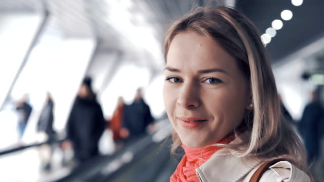 Young-blond-woman-is-riding-on-the-travelator