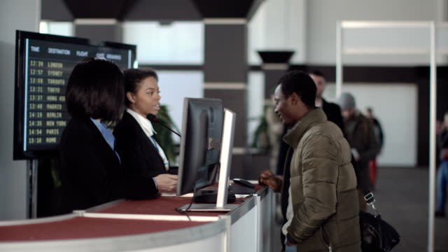 Airport-security-personnel-checking-identification