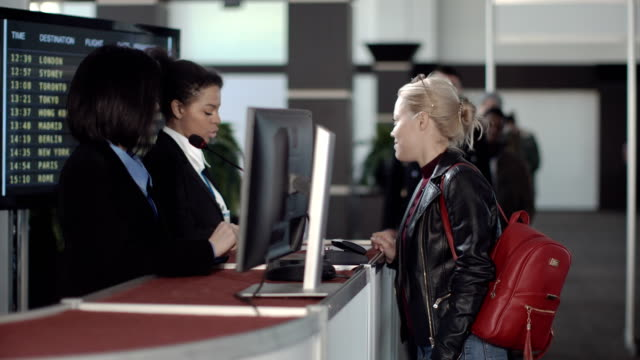 Airport-security-personnel-processing-passengers