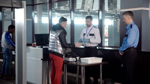 Guard-checking-passenger-bag-in-airport