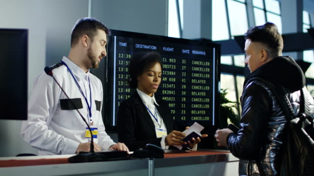 Man-passing-biometric-control-at-counter