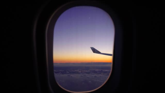airplane-window-view-at-sunset-sunrise-passenger-aircraft-aviation-airline-flying-traveling