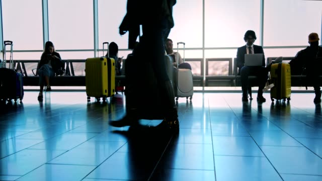 Multi-ethnic-crowd-of-people-at-airport-gate-waiting-room