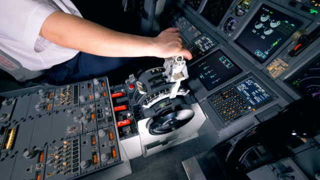 Pilot-holds-his-hand-on-a-lever-in-a-cockpit-close-up-4K-