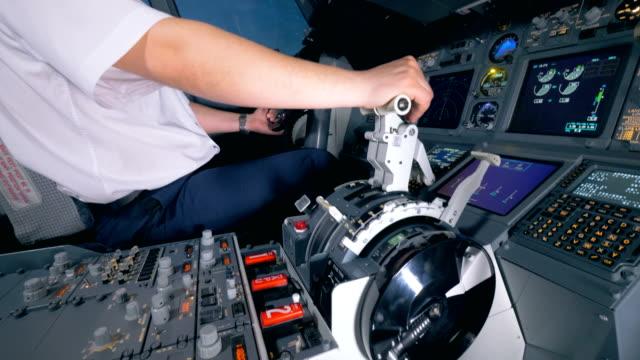An-airman-controls-a-plane-close-up-