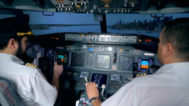 Pilots-control-an-airbus-in-a-flight-simulator-