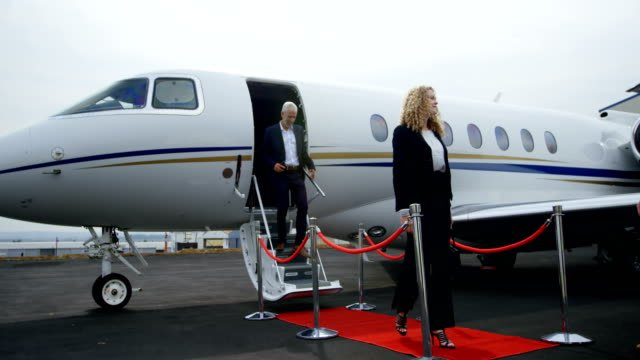 Business-people-leaving-private-jet-4k