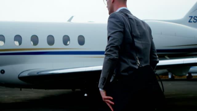 Businessman-walking-towards-private-jet-4k