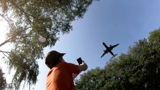 Airplane-flies-over-a-boy-on-landing