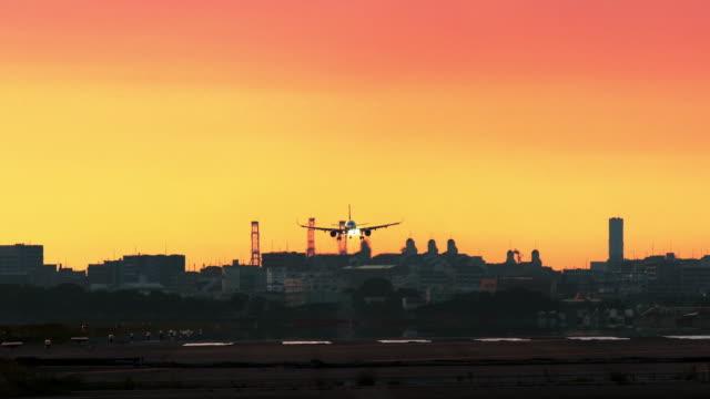 Jet-plane-landing-on-airport-in-sunset