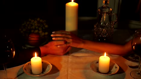 Close-up-Of-The-Hands-Of-Men-Holding-Women-s-Hands-During-A-Romantic-Dinner