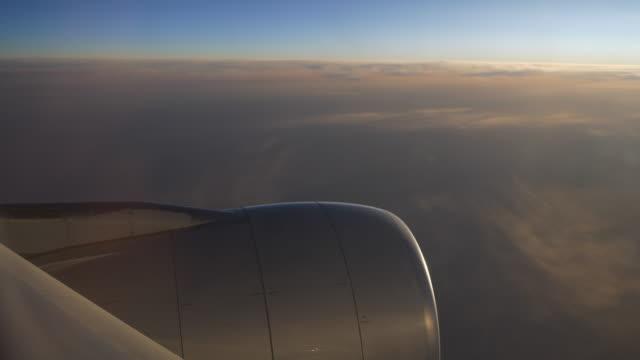 sun-light-airplane-window-seat-view-on-engine-4k-china