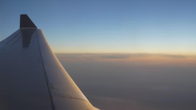 sunset-sun-light-airplane-window-seat-wing-view-4k-china