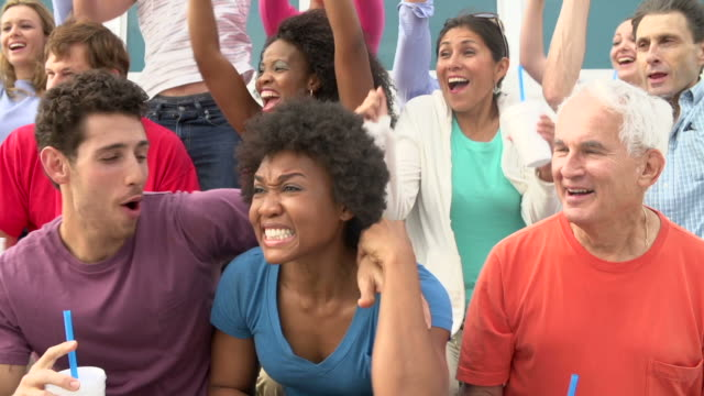 Spectators-Cheering-At-Outdoor-Sports-Event-In-Slow-Motion