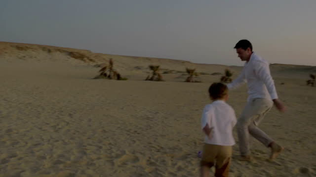 Active-game-with-child-on-the-beach-at-sunset