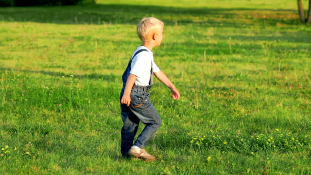 Elementary-aged-boy-kicking-ball-in-the-field