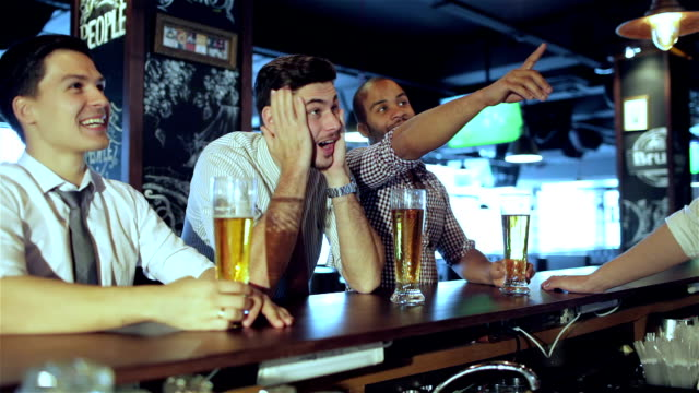 Men-fans-watching-football-on-TV-and-drink-beer