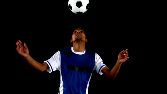 Handsome-man-juggling-a-football