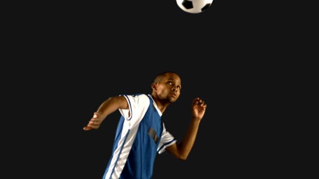 Football-player-heading-the-ball