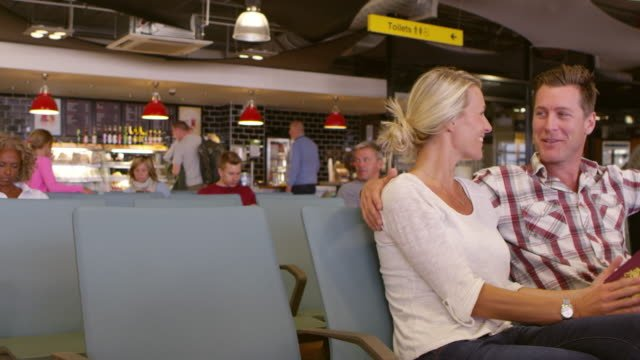 Couple-Waiting-In-Airport-Departure-Lounge-Shot-On-R3D
