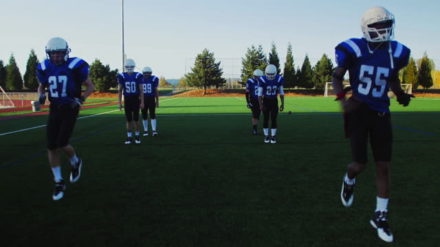 Football-players-warming-up-before-a-game