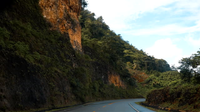 View-from-the-car-driving-by-the-asphalt-road-in-Puerto-Plata-Dominican-Republic