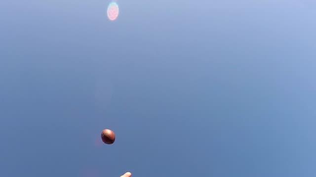One-handed-juggling-footbal-catch-in-slow-motion
