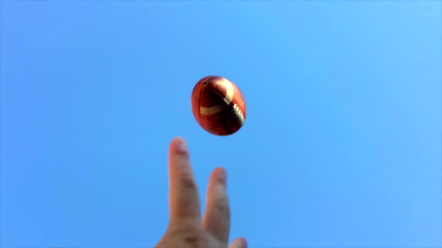 Super-slow-motion-of-hands-catching-football
