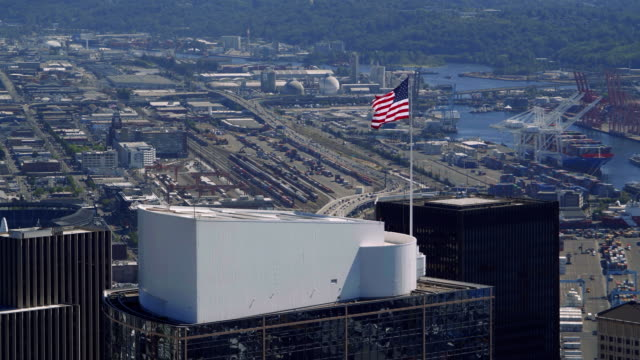 American-Flag-Waving-on-Building-Top-Slow-Motion-Aerial