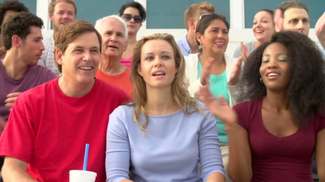 Spectators-Clapping-At-Outdoor-Sports-Event-In-Slow-Motion