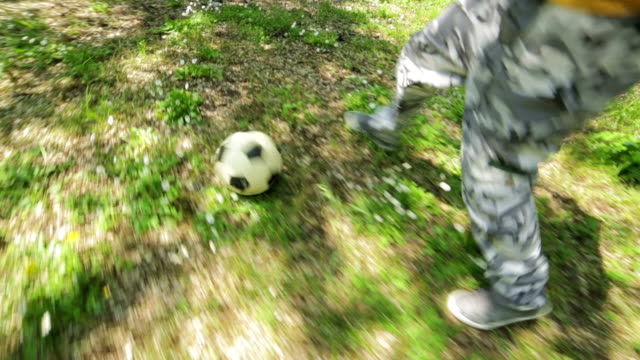 sequence-on-child-playing-football-in-the-garden:-outdoor-soccer-run-children